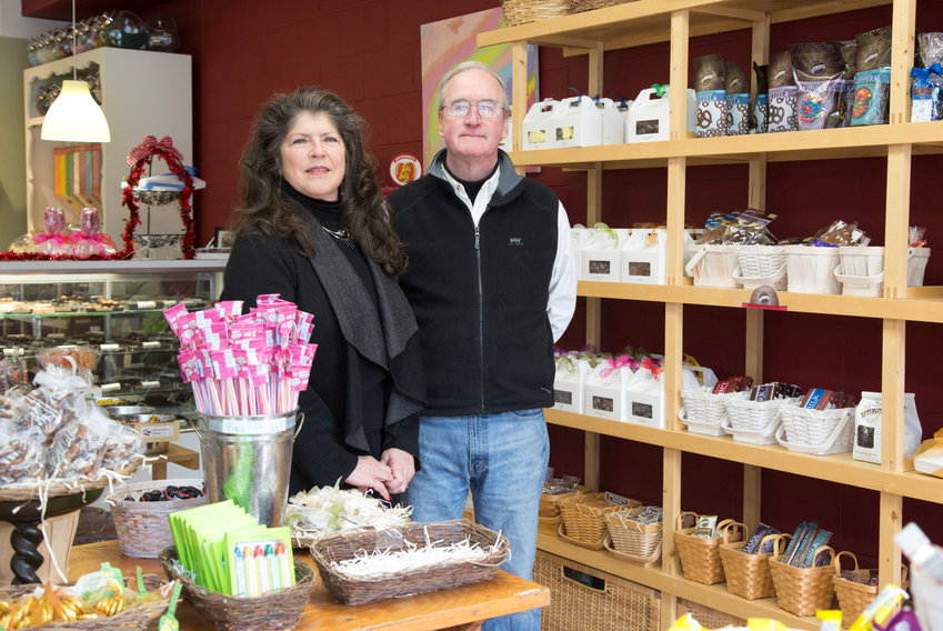 Bob and Mufi Sullivan, surrounded by candy at their Barrington shop Sweet Lorraine's