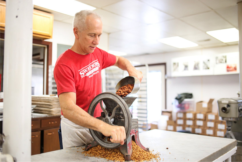 Brian Sweenor busy at work making Almond Buttercrunch