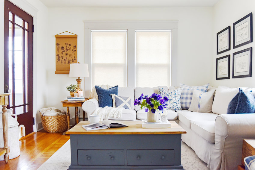 Natural tones and blues infuse neutral spaces with warmth