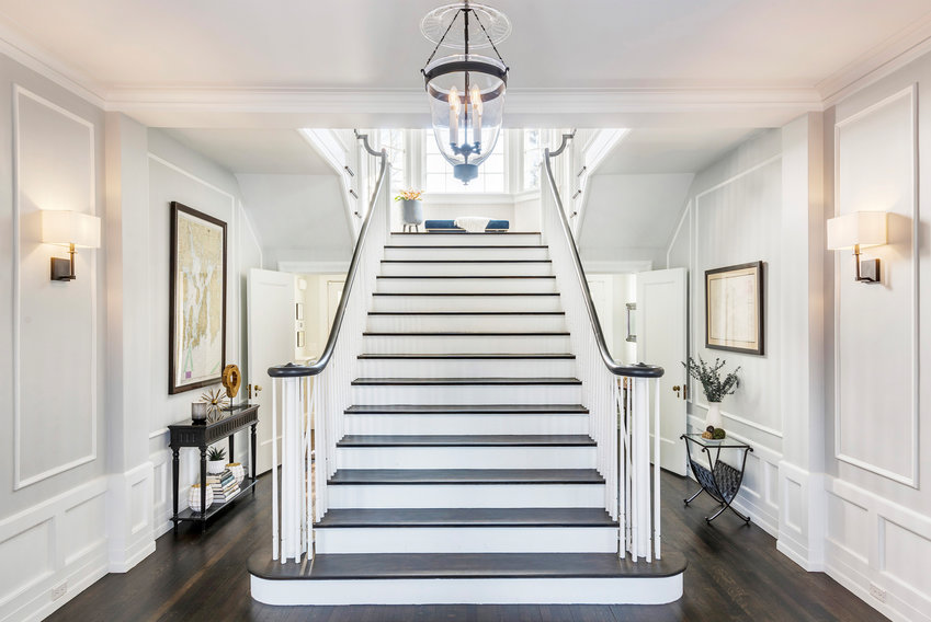Fresh coats of paint and updated lighting make this staircase a stunner