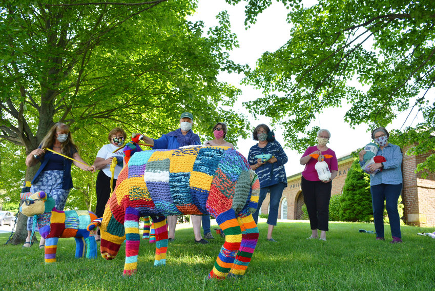 La Yarn Bomb-Baa, by Jamestown's knitting group Needles Galore, features acrylic yarn, powder-coated topiary wire, and netting.