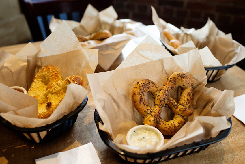 The Malted Barley raises the bar on pub fare with their signature gourmet pretzels, handmade sandwiches, and selection of craft beers.