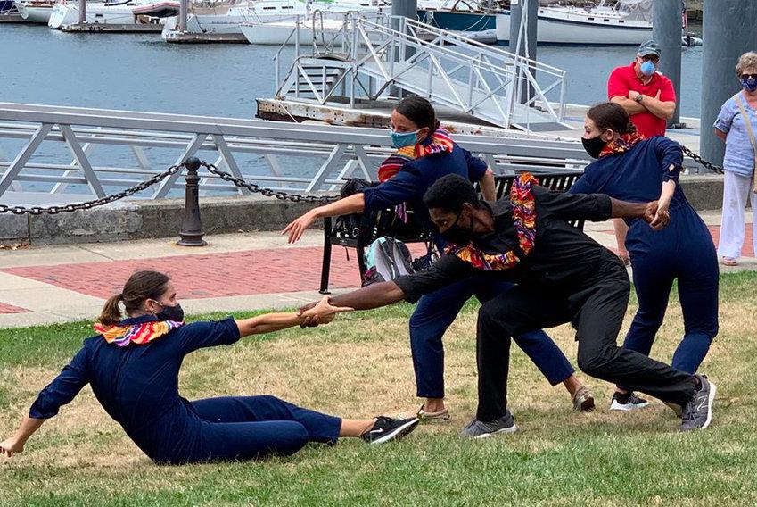 Company members Emily Baker, Lauren Difede, Jose Losada, and Emily Small dance in Perrotti Park.