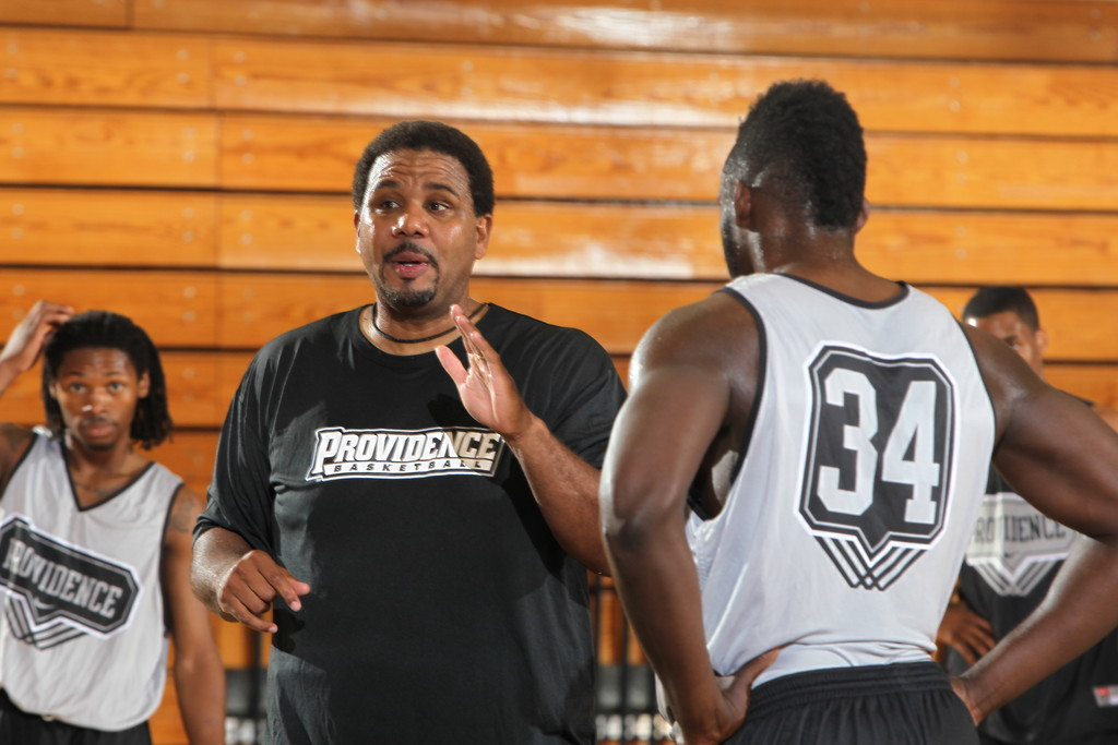 Coach Ed Cooley (center) with some of his players