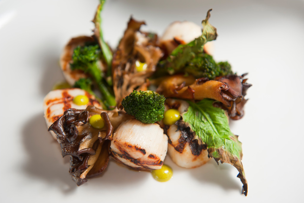Grilled scallops, hen of the woods mushroom, broccoli, lovage, and bonito dashi