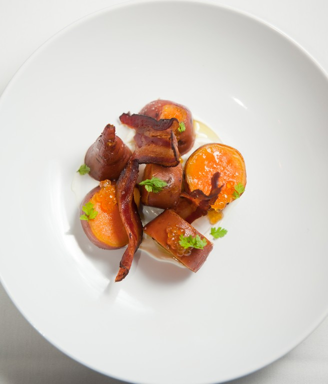 Steamed sweet potatoes with Tasso ham,smoked artic char, pine and sour cream
