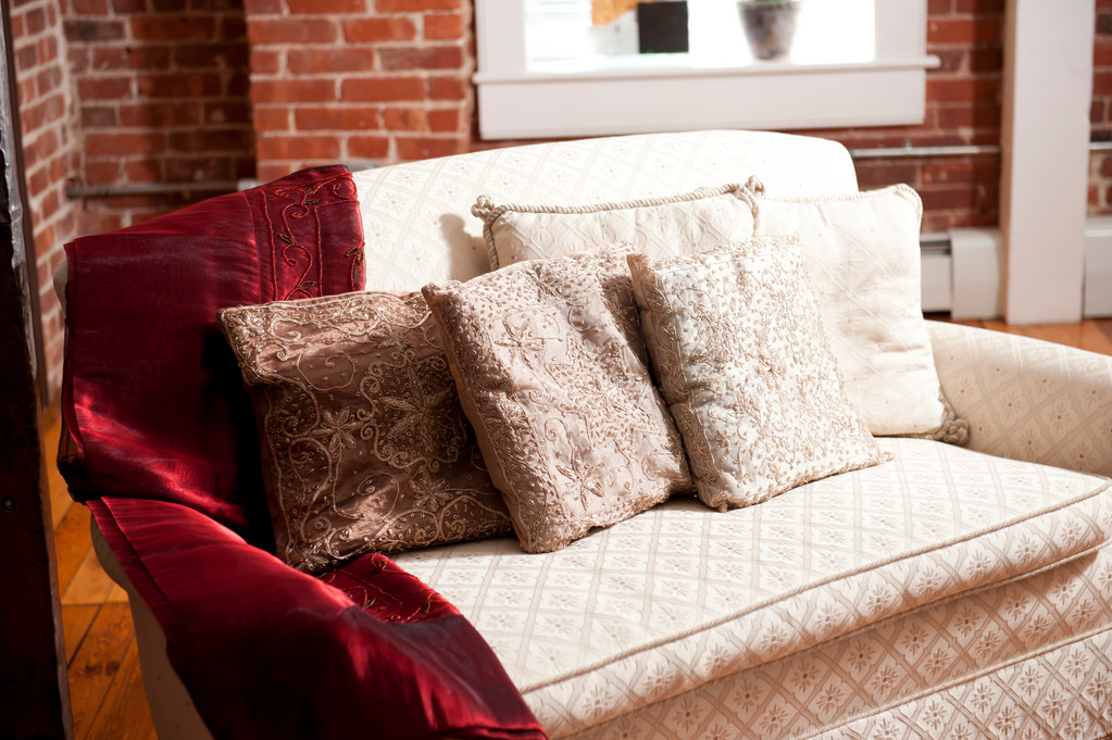 """That couch was my grandmother's. It desperately needs a facelift, but it reminds me of her so I have dragged my feet on it. The pillow cases are from a Chelsea flea market in New York City I bought more than 10 years ago. They have followed me somehow."""