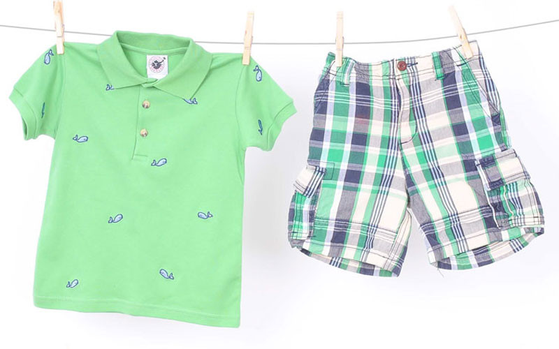 Green rugby with blue whales, $4.99 at The Children's Orchard; plaid shorts, $6.95 at Luca