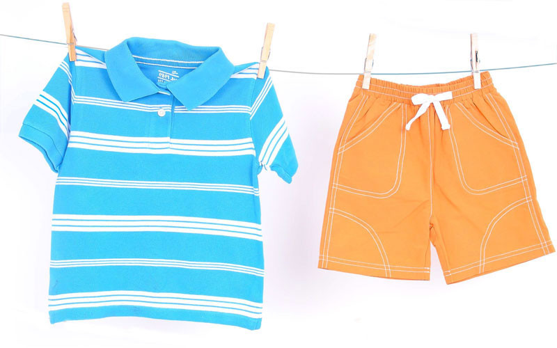 Blue striped rugby, $6.50 at Just Ducky; orange swim trunks, $29 at Little Purls