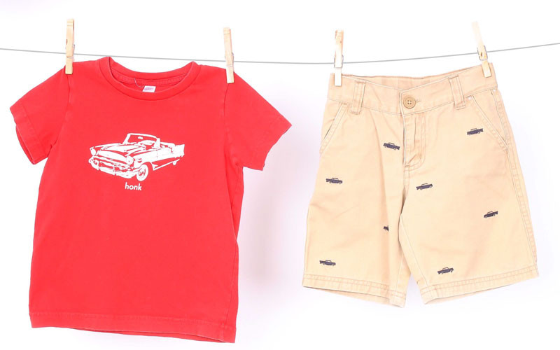"""Honk"" t- shirt, $5.95 at Luca; khaki shorts with cars, $7.50 at Just Ducky."