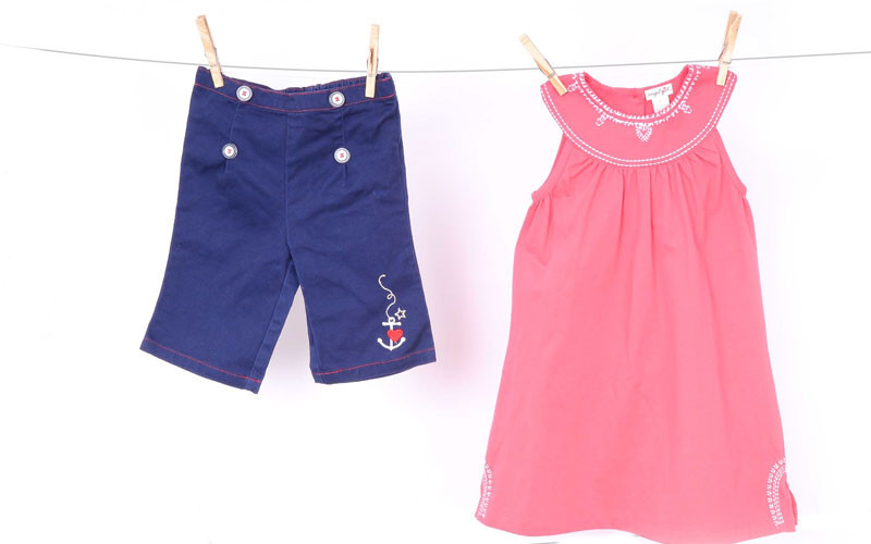 Navy capris (part of a two-piece set), $10.50 at Luca; coral sundress, $48 at Little Purls