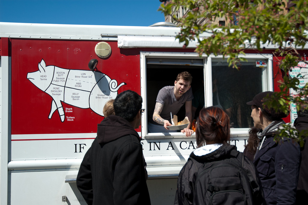 Food Truck Tuesdays, organized by the Downcity marketing group, brings trucks like Hewtin's Dogs Mobile, Poco Loco, Fancheezical and more to Grant's Block, attracting a hungry lunchtime crowd.