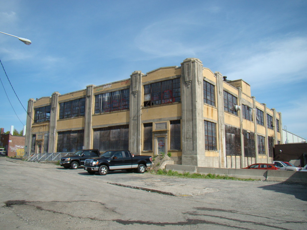 Former RIDOT Headquarters and Garage  The former headquarters for the Rhode Island Department of Transportation was built in 1927 and was one of the first modernist buildings erected by the State of Rhode Island. Plans for its demolition were halted but it is currently being underutilized due to the underdevelopment of plans to re-establish the building as a garage.