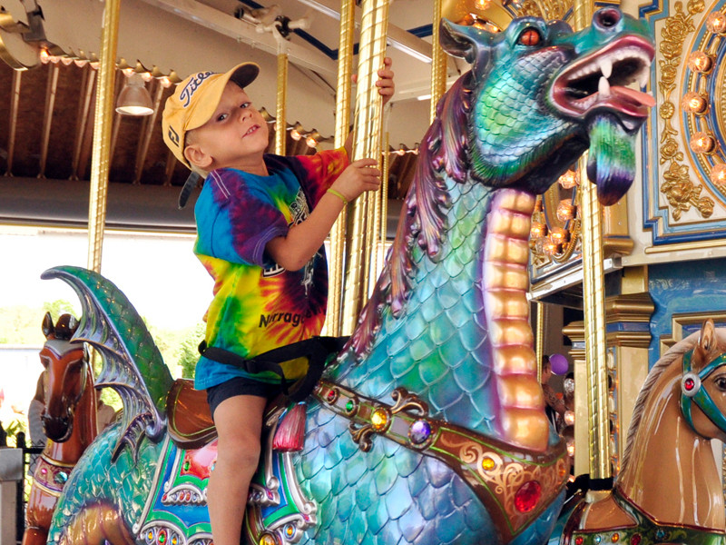 Kids can ride the carousel at Adventureland in Narragansett