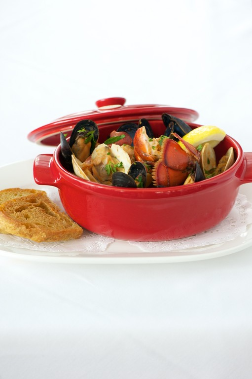 Jamestown Fish Crockpot with lobster, mussels, clams, scallops, monkfish, potatoes and chourcio