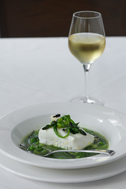 Line caught Maine Halibut with basil broth and spring vegetables