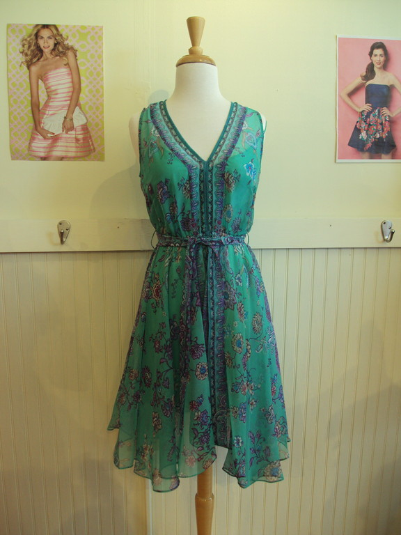 This gorgeous sea foam green floral pattern dress is from Laundry by Sheli Segal. It is made of a light sheer fabric sporting the uneven hemline trend. It's a great summer piece because of the lightness of the material and the fun print, and it is versatile enought to wear for an evening out or a day of casual fun. 