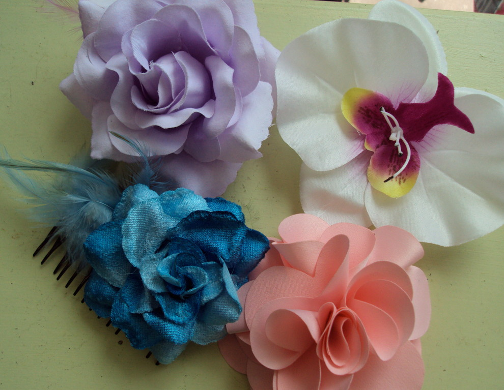 Flowers go hand-in-hand with warm weather and tropical locales, and present a fun, new way to express the quirky side of your personality. These flower fashions come in clips, combs, and brooches to wear with any outfit.