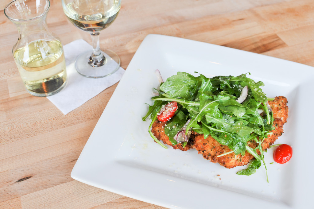Chicken Milanese - baby arugula, red onion, lemon, pear tomatoes, olive oil
