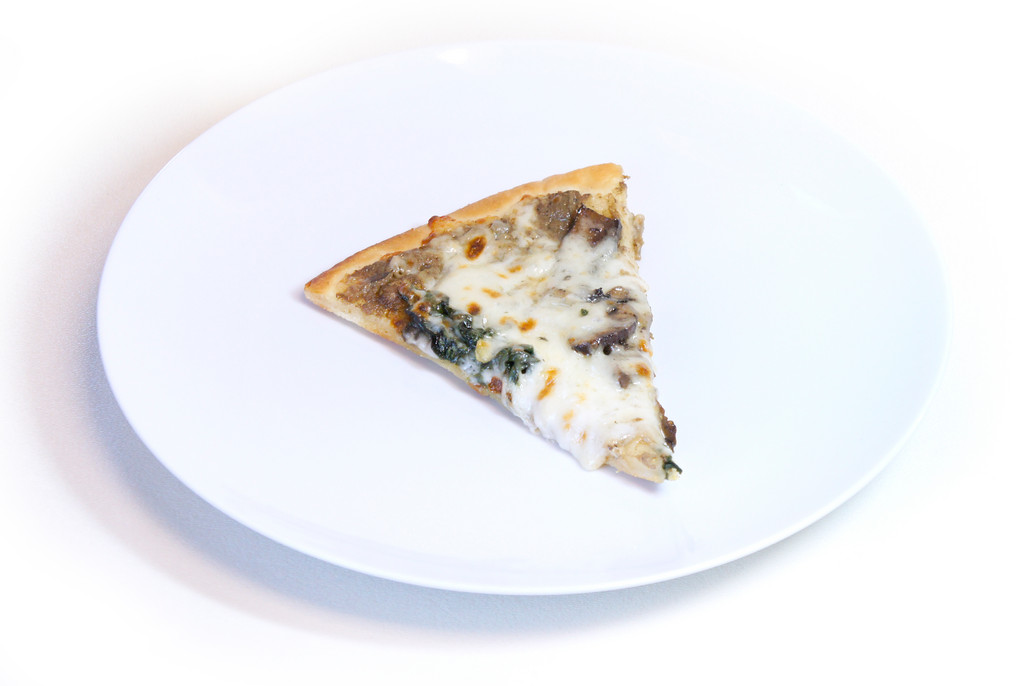 Eleven Forty NineThis Mushroom pizza packs a gourmet flavor punch despite its small size. The pie is topped with mushroom, mushroom cream, sauteed garlicky spinach and topped with fresh mozzarella and then, to top the whole show off, a drizzle of truffle oil. This version offers us the thickest crust of the bunch, but the softness of the dough really lets the complex flavors shine. The rich flavors really come together in this little delicacy. What it lacks size it more than makes up for in flavor. 1149 Division Street, Warwick. 884-1149