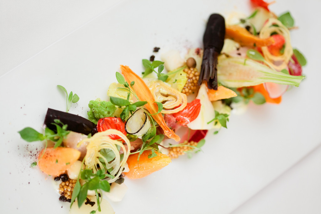Warm vegetable salad with vegetable crisps and creamy herbed buttermilk vinaigrette