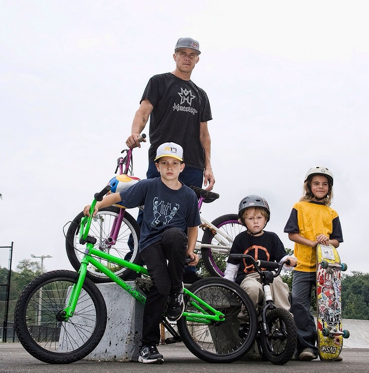 When he isn't competing, Kevin Robinson, pictured here with his three children, works hard to promote kids' involvement in sports through the K-Rob Foundation