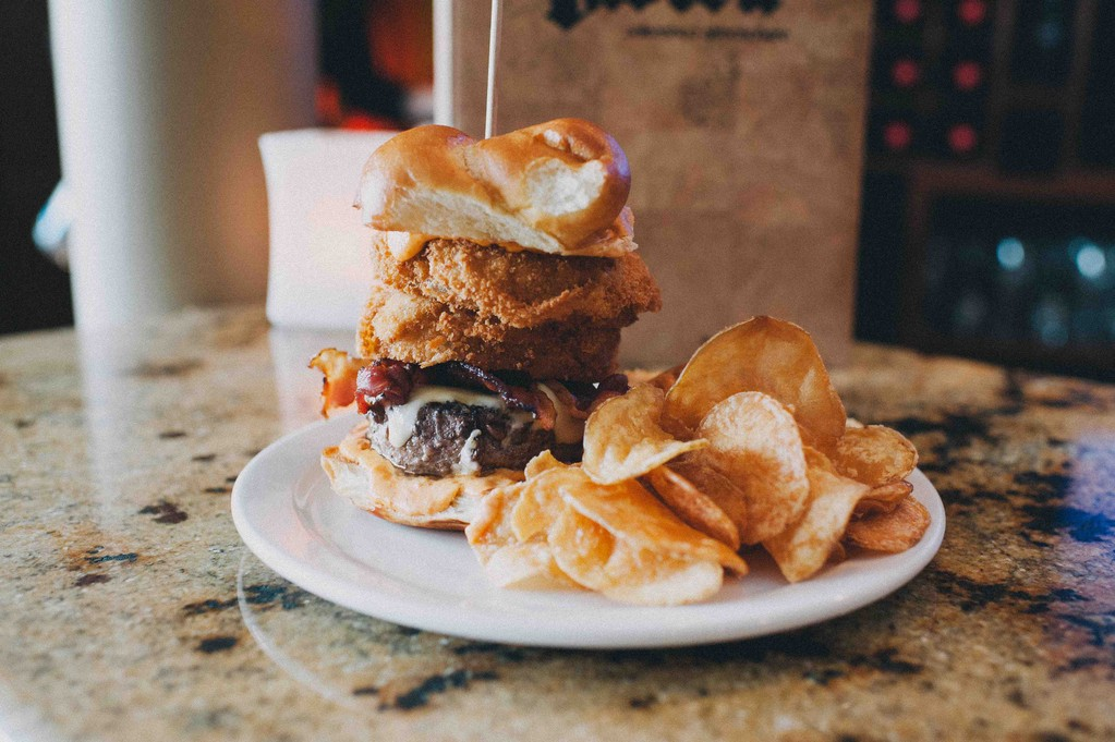 Hand-pressed burger with hot chili mayo, bacon and onion rings