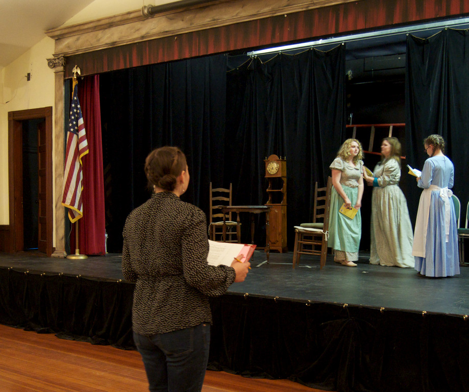 Carie Monroe directing a dress rehearsal of Little Women, her senior project at Tiverton High School