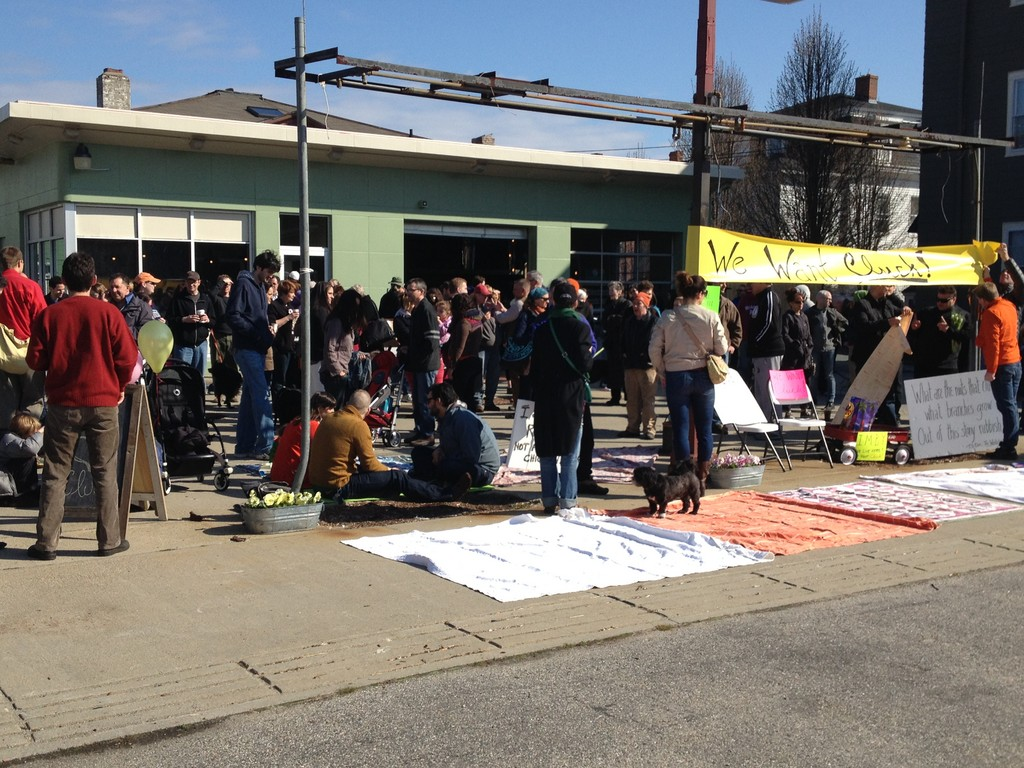 About 200 supporters rallied for cluck! on April 14