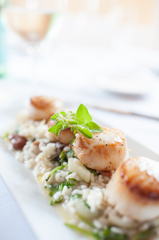 Canestrelli Tartufati: Pan-seared sea scallops with fava beans over braised citrus fennel risotto