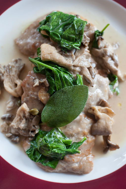 medaglioni di vitello: veal paillard with a lemony cream sauce, Pantelleria capers, sautéed organic spinach and oyster mushrooms