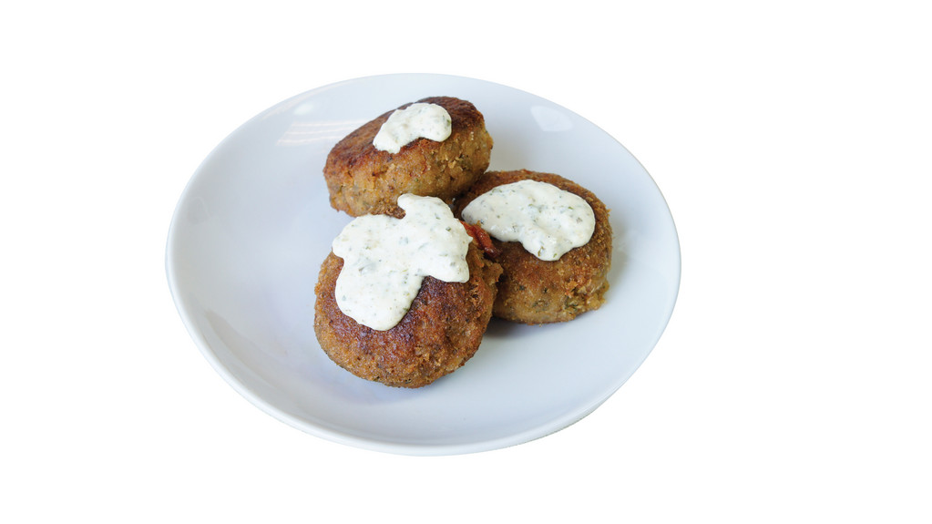 The Mermaid Café  These crab cakes offer nothing less than pure shredded crabmeat with a hint of sweetness. Pair the patties with Mermaid Cafe's dill-packed tartar sauce to experience a flavorful balance for those warm New England summer nights. 19 Margin Street, Westerly. 637-4225.