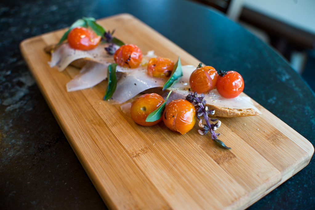 House-Cured Lardo with Blistered Cherry Tomatoes and Crostini
