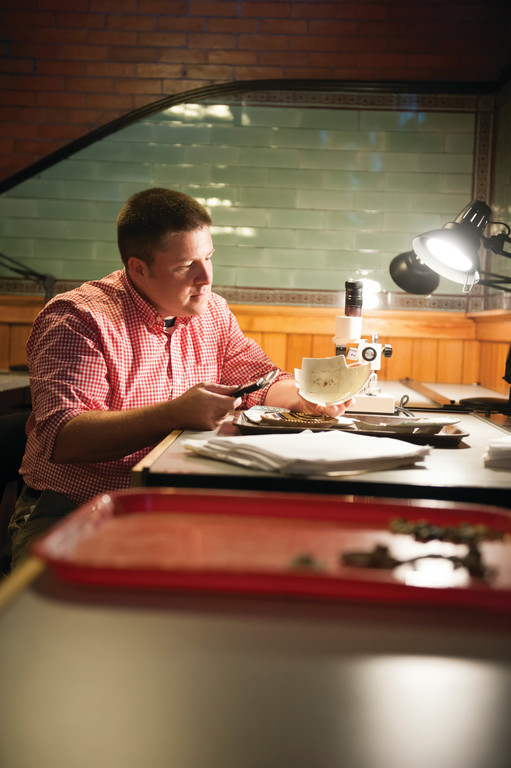 Dr. Marcoux studying excavated pottery in his lab at Salve Regina