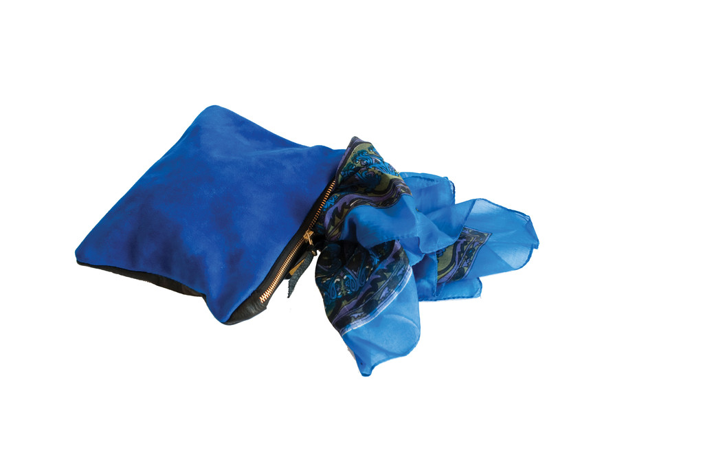 Bold in BlueBlue suede and black leather clutch, $84; printed silk scarf, $22 both a Shoppe Pioneer. Shoppe Pioneer As a premier women's fashion and lifestyle boutique, Shoppe Pioneer offers exclusively curated fashion finds coupled with unique gifts perfect for the rest of life. 253 S. Main St., Providence. 274-7467.