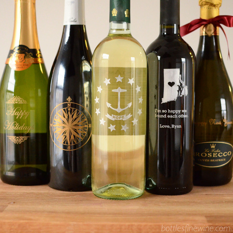 Bottles can engrave almost anything! Give a bottle of wine etched with Rhode Island's Hope Anchor, a Christmas greeting, or a special message. Order now!