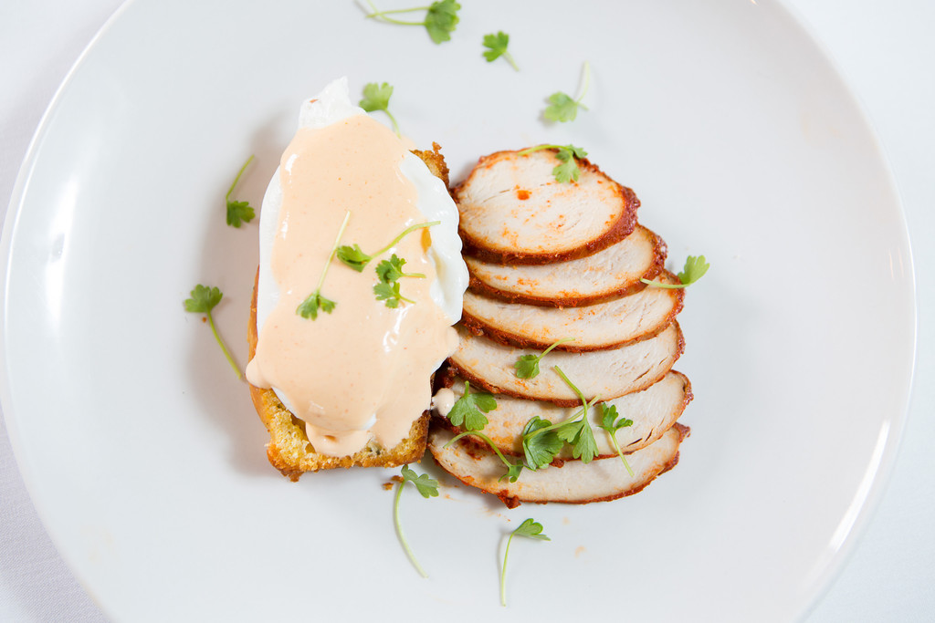 Paprika-smoked Chicken Benedict with hollandaise and poblano corn bread