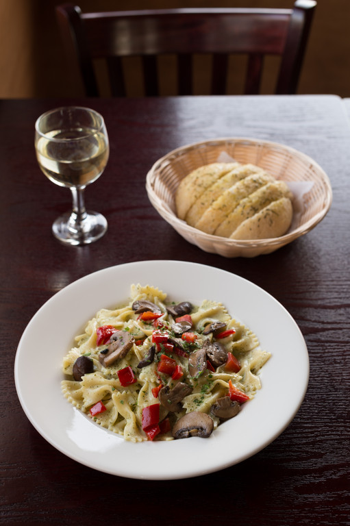 Pasta Bowl with creamy basil pesto sauce, mushrooms and roasted red peppers