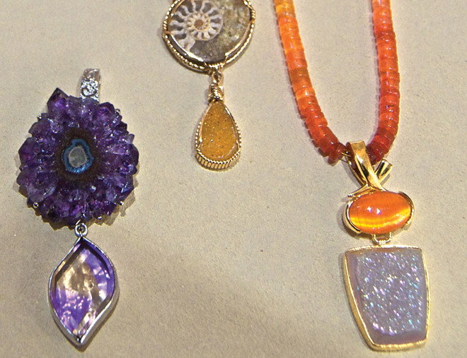 Rare Earth Pendants including cat- seye fire opal pendant, on a carnelian beaded necklace