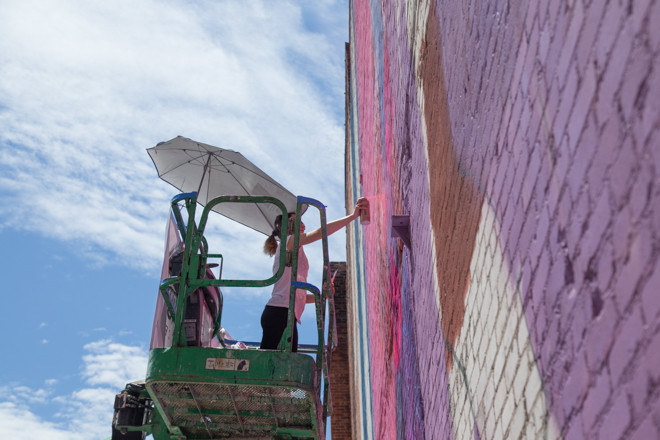 Natalia Rak working on her mural in downtown Providence on Friday, June 5.