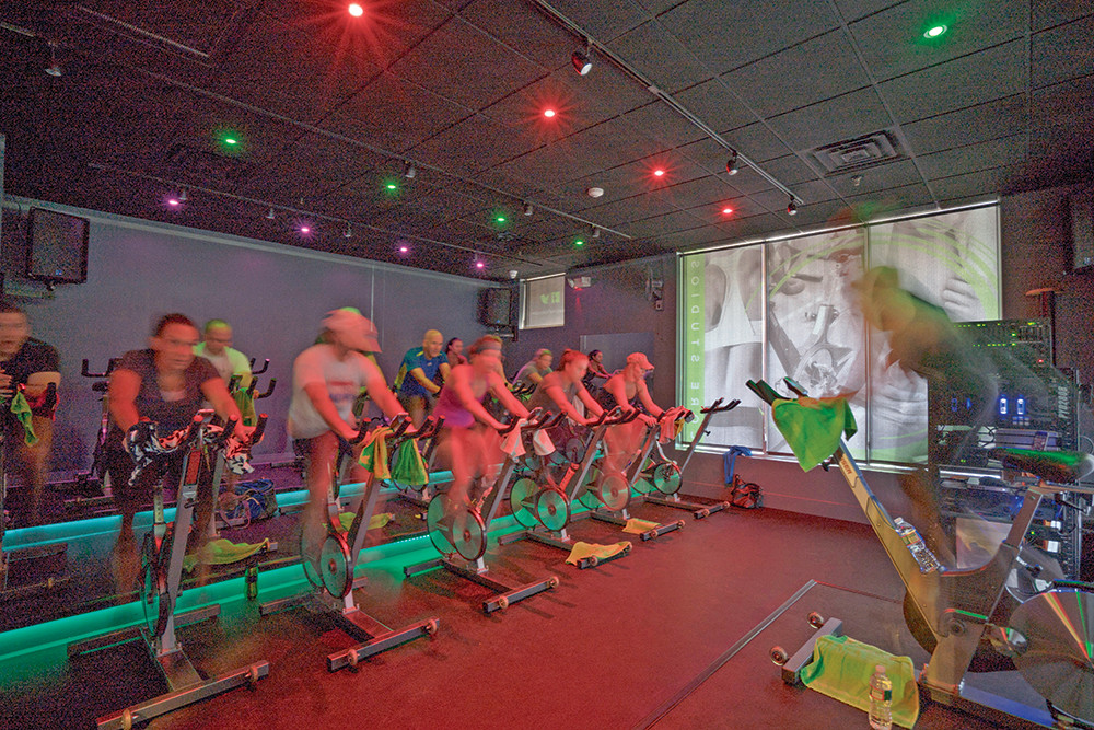 The Spin Room at CORE Cycling + Fitness is a blur of intense workout.