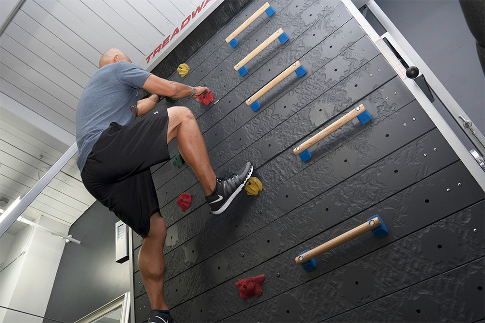 Enter the rock climbing wall that never, ever ends.