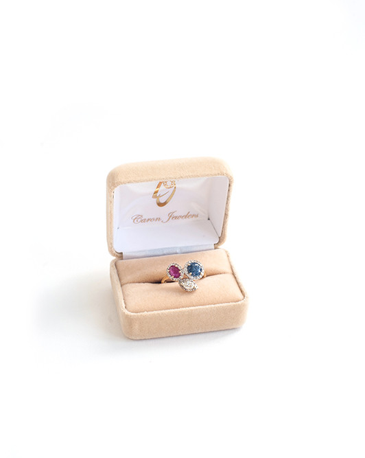 Ring in the Season – 14kt sapphire, ruby and diamond ring; $2,000 at Caron Jewelers