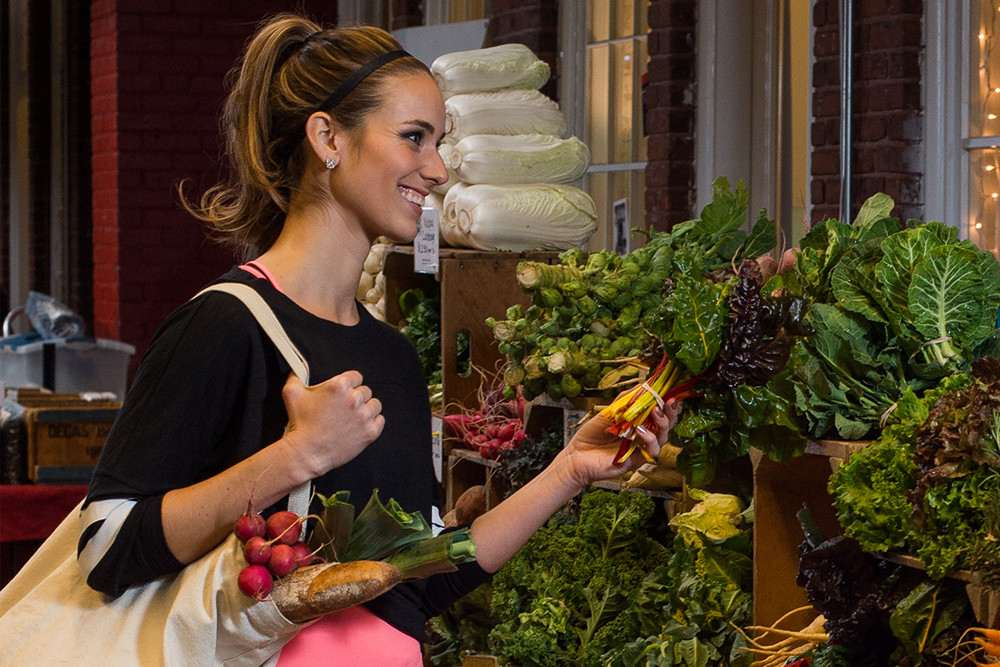 Michaela Johnson of The Rhode Show shops local at the Wintertime Farmers Market at Hope Artiste Village in Pawtucket