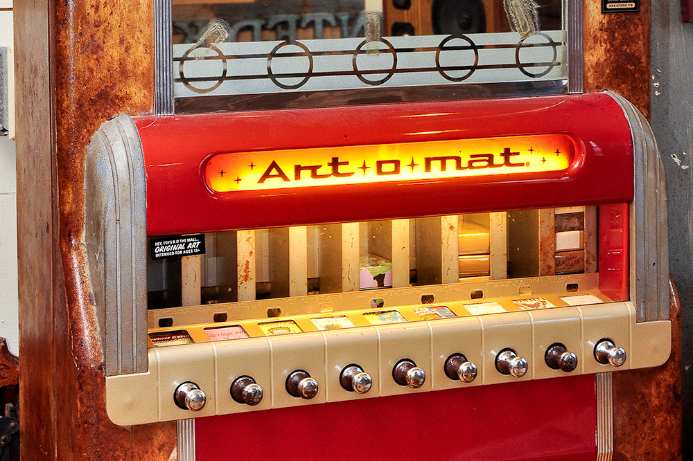 An old cigarette machine gets a new life dispensing pieces of art