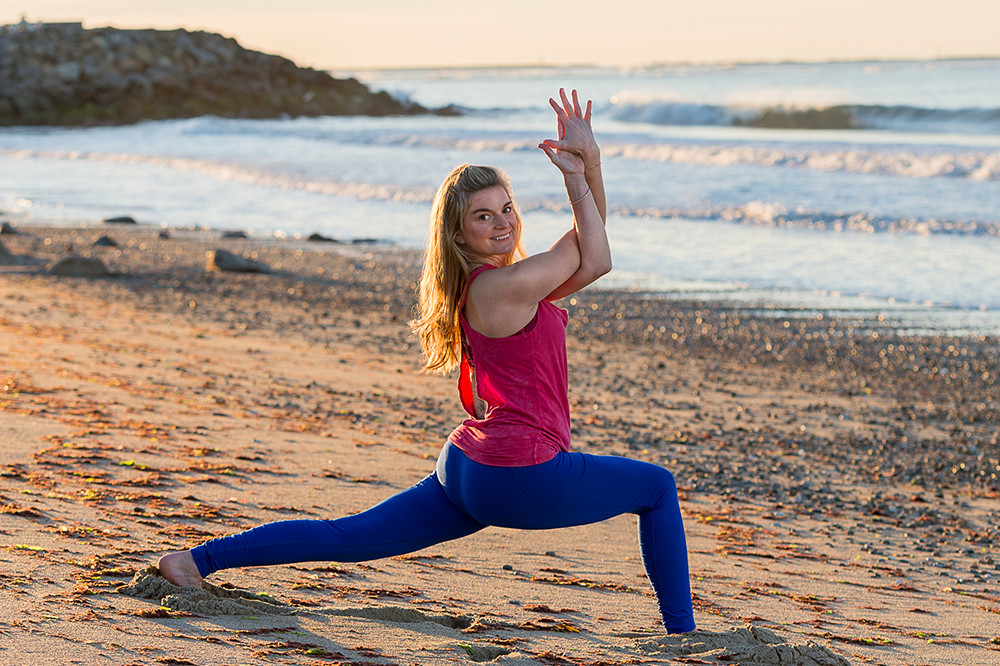 Coral Brown leads All That Matters' Beach Yoga on South Kingstown Town Beach