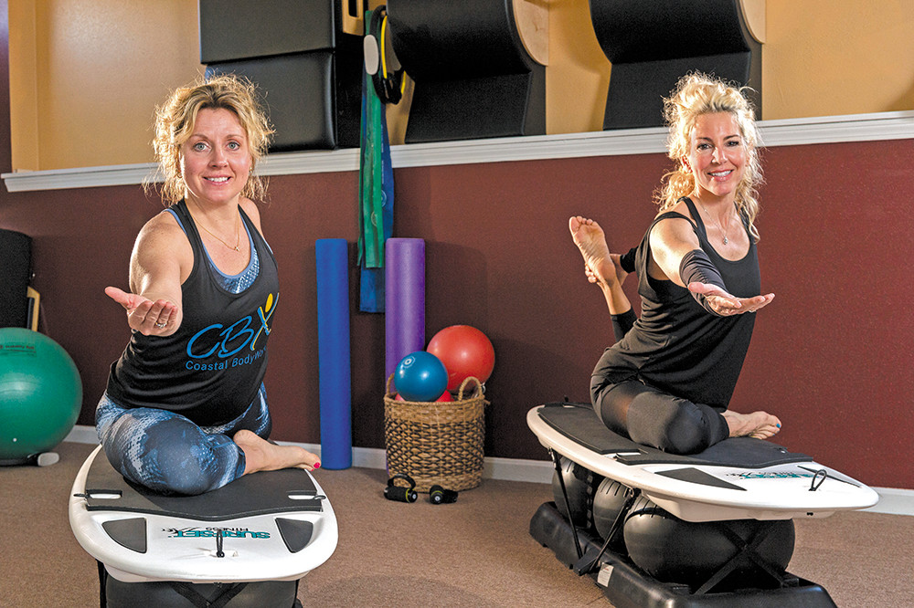 Deborah McElkenny (left) leads surfset classes at Coastal Body Worx