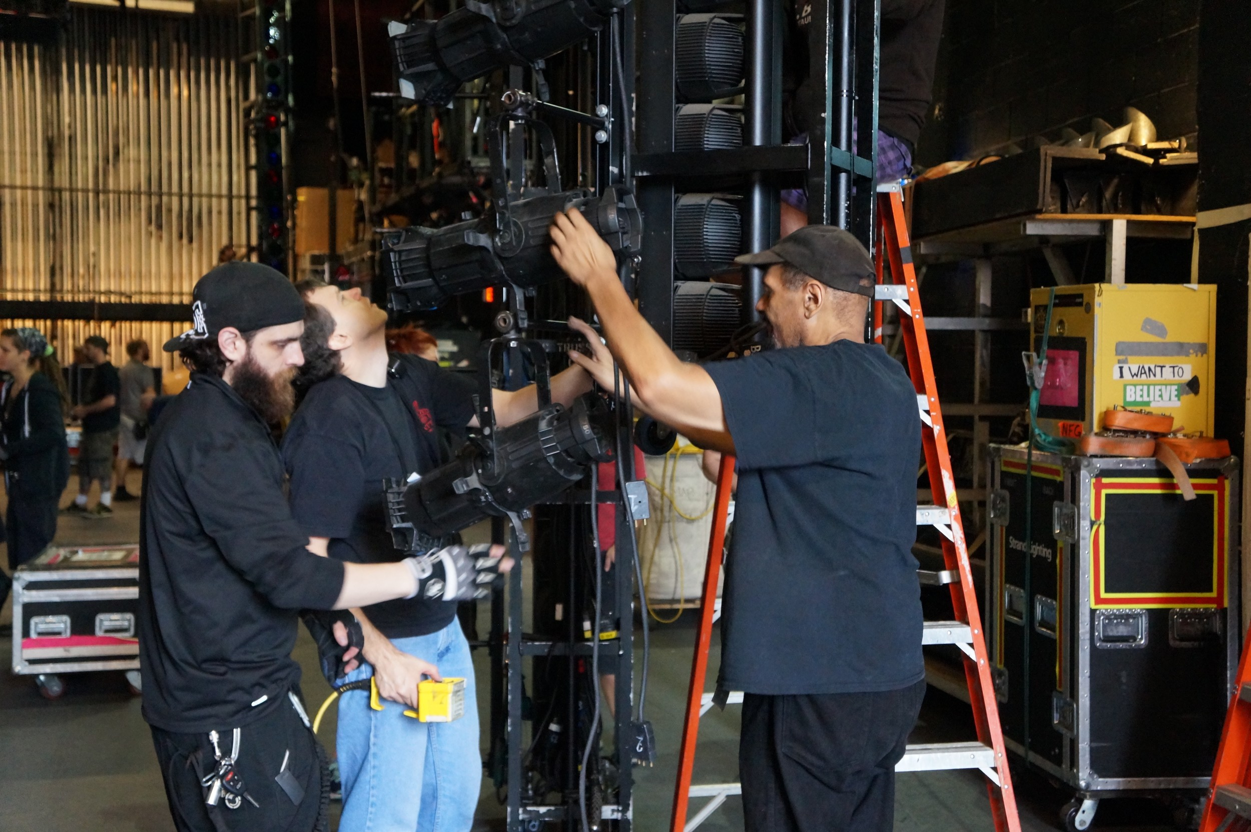 Crew members prepare the lights