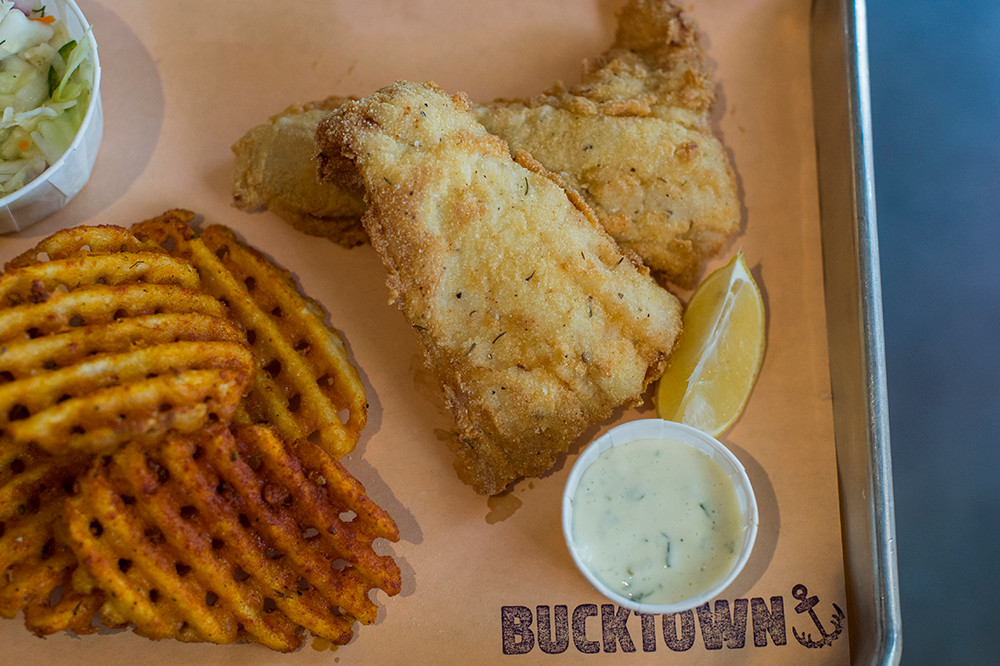 Fried fish dinner with waffle fries