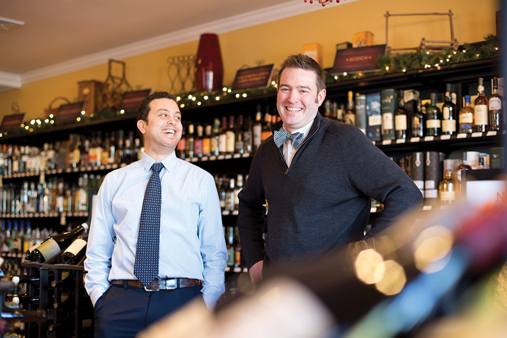 Wine expert Marc Berry and spirits specialist Justin Garrison of Grapes and Grains help customers navigate local beverages and Valentine's Day recommendations